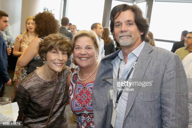Martha Moore Bebe Evans and Steve Lassiter attend APA Nashville's open house at One Nashville Place on June 6 2017 in Nashville Tennessee