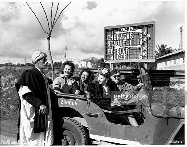 Martha Raye Caroll Landis and Kay Francis ask a local Algerian for directions as they drive toward Algiers | Location West of Algiers Algeria