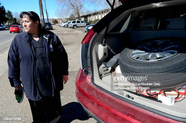 Martha Rodriguez stands next to the red Ford Edge that was stolen from Longmont with her son Allen ChavarriaRodriguez in it earlier this morning on...