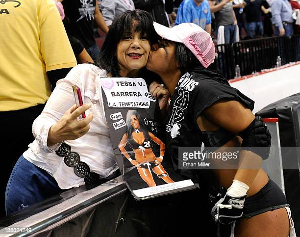 Martha Ruiz celebrates with her daughter Tessa Barrera of the Los Angeles Temptation after the team defeated the Philadelphia Passion 286 to win the...