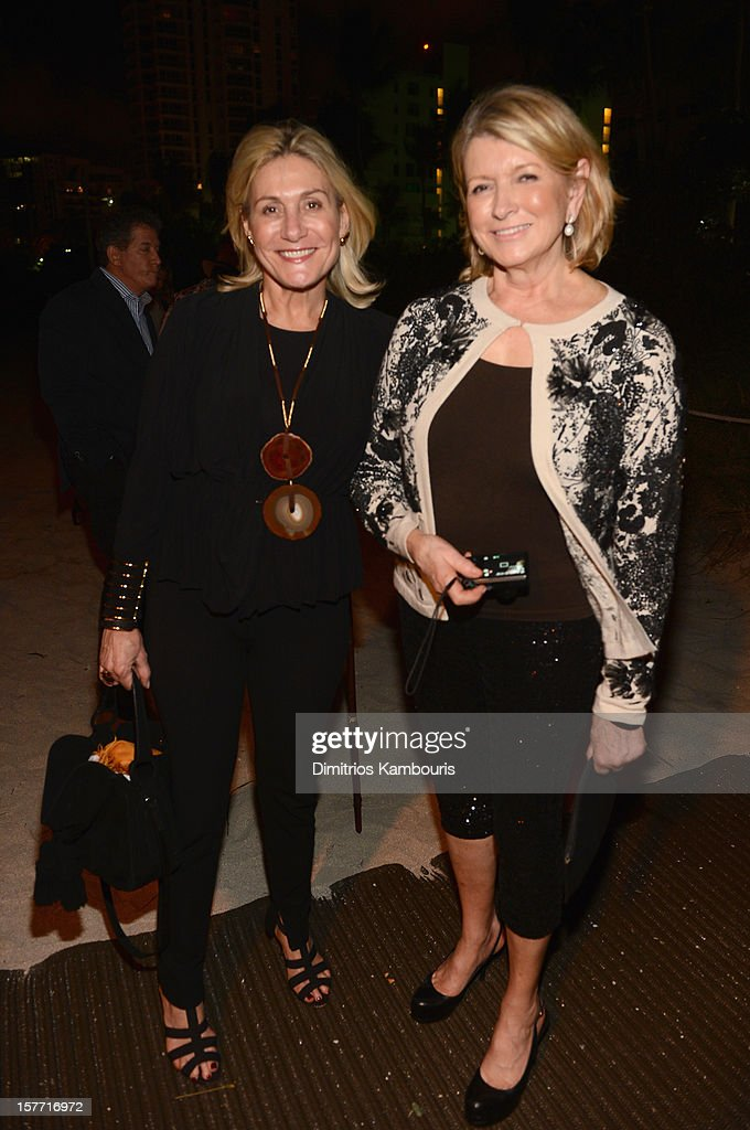 Martha Stewart (R) and guest attend a Beachside Barbecue presented by CHANEL hosted by Art.sy Founder Carter Cleveland, Larry Gagosian, Wendi Murdoch, Peter Thiel and Dasha Zhukova at Soho Beach House on December 5, 2012 in Miami Beach, Florida.