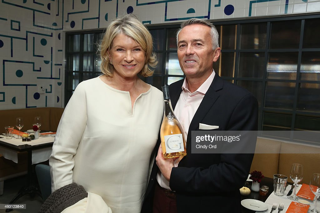 Martha Stewart and National Fine Wine Director at Shaw-Ross Paul Chevalier pose at the Rose Brunch Hosted By Martha Stewart during Food Network & Cooking Channel New York City Wine & Food Festival presented By FOOD & WINE at Beauborg on October 17, 2015 in New York City.