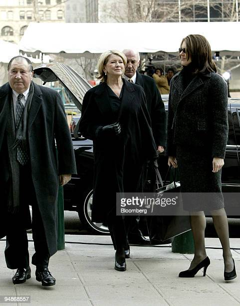 Martha Stewart center arrives at the federal courthouse in New York February 17 2004 Also seen are her attorney Robert Morvillo left and daughter...