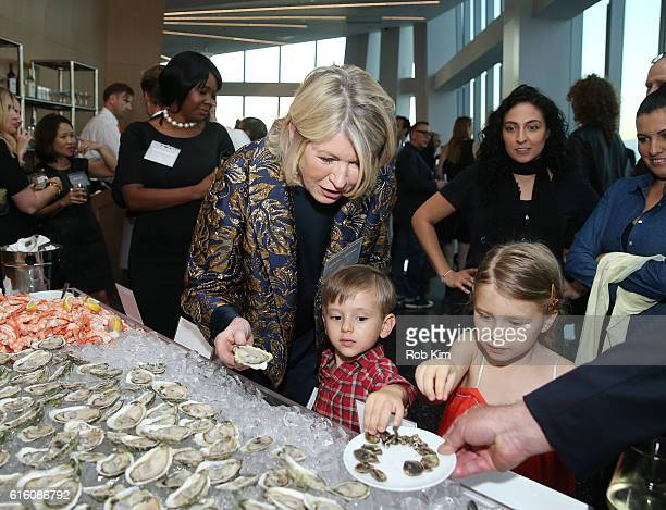 Martha Stewart enjoys fresh oysters with her grandchildren at a cocktail reception for Martha Stewart American Made at One World Observatory on...