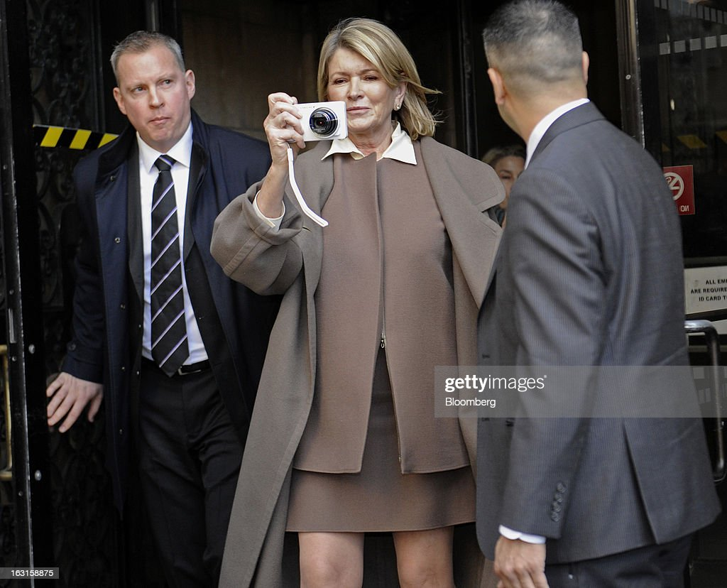 Martha Stewart, founder of Martha Stewart Living Omnimedia Inc., center, takes photos while exiting State Supreme court in New York, U.S., on Tuesday, March 5, 2013. Stewart took the stand in a Manhattan courtroom today as Macy's Inc. continues its fight to persuade a New York state judge to block parts of her company's agreement with J.C. Penney Co. Photographer: Louis Lanzano/Bloomberg via Getty Images