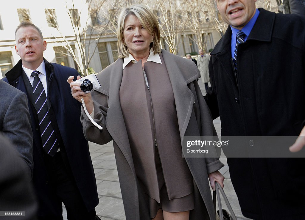 Martha Stewart, founder of Martha Stewart Living Omnimedia Inc., center, holds a camera while exiting State Supreme court in New York, U.S., on Tuesday, March 5, 2013. Stewart took the stand in a Manhattan courtroom today as Macy's Inc. continues its fight to persuade a New York state judge to block parts of her company's agreement with J.C. Penney Co. Photographer: Louis Lanzano/Bloomberg via Getty Images
