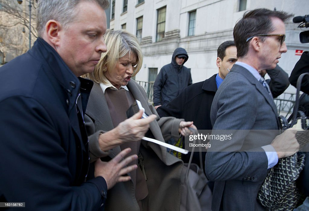 Martha Stewart, founder of Martha Stewart Living Omnimedia Inc., second right, stumbles after exiting State Supreme court in New York, U.S., on Tuesday, March 5, 2013. Stewart took the stand in a Manhattan courtroom today as Macy's Inc. continues its fight to persuade a New York state judge to block parts of her company's agreement with J.C. Penney Co. Photographer: Jin Lee/Bloomberg via Getty Images