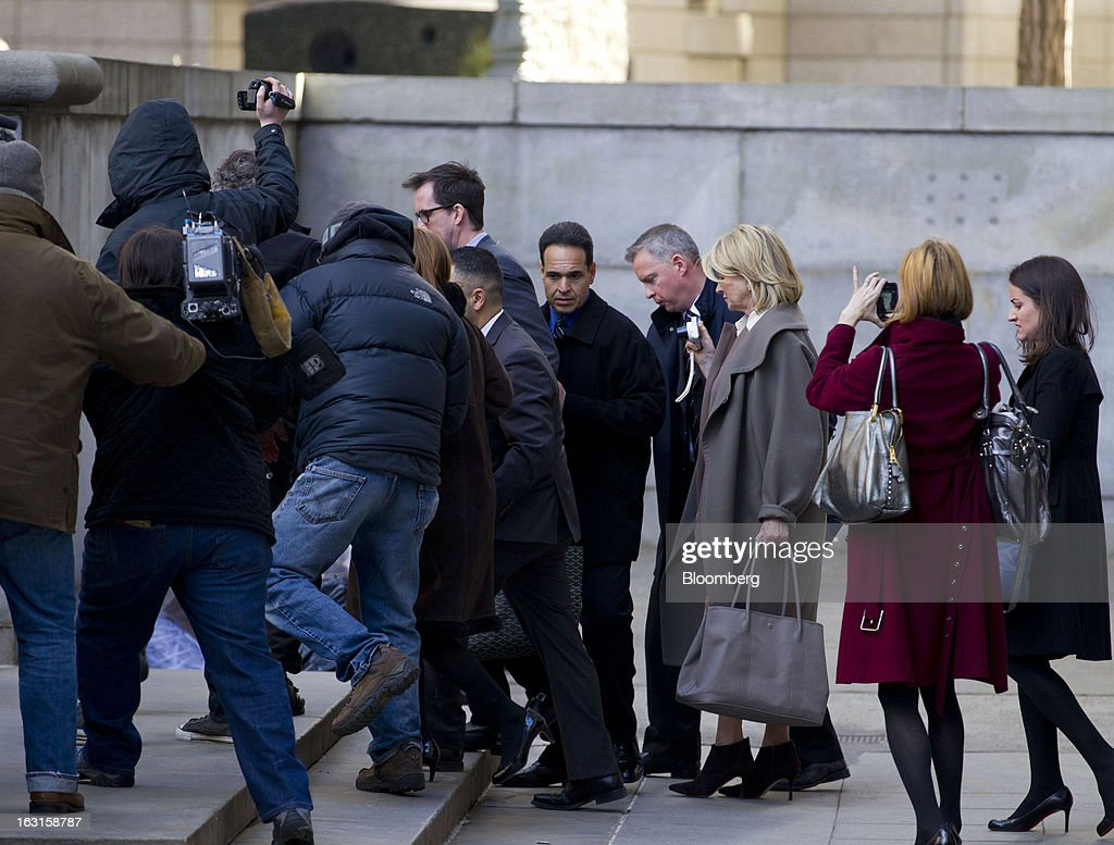 Martha Stewart, founder of Martha Stewart Living Omnimedia Inc., third right, exits State Supreme court in New York, U.S., on Tuesday, March 5, 2013. Stewart took the stand in a Manhattan courtroom today as Macy's Inc. continues its fight to persuade a New York state judge to block parts of her company's agreement with J.C. Penney Co. Photographer: Jin Lee/Bloomberg via Getty Images