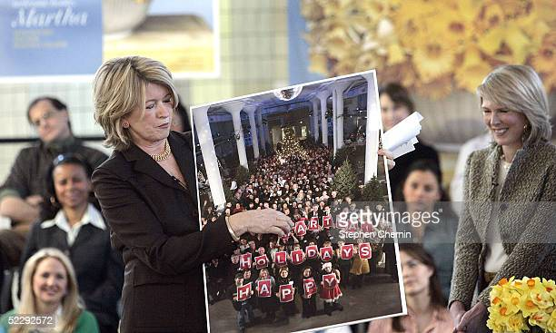 Martha Stewart holds a Christmas card from her employees she received when she was in prison during an address to an audience of her employees and...