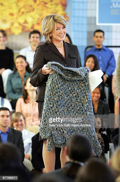 Martha Stewart holds up a shawl crocheted by a fellow inmate from Alderson Federal Prison Camp in Alderson WVa where she served five months for a...