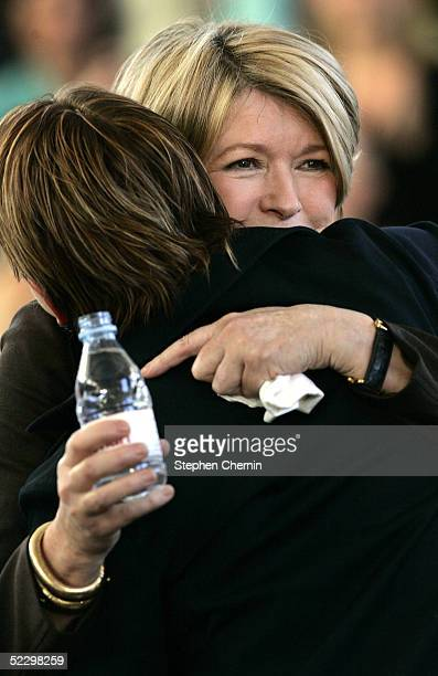 Martha Stewart hugs her daughter Alexis after speaking to an audience of her employees and the media on her first day back to her offices since her...