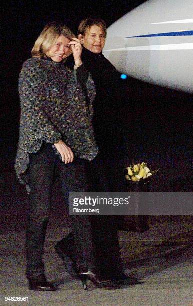 Martha Stewart left walks to her private jet at Greenbrier Valley Airport in Lewisburg West Viriginia with her daughter Alexis early Friday March 4...