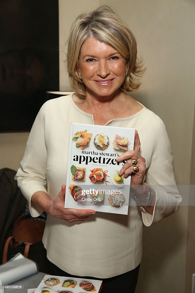 Martha Stewart poses with her book at the Rose Brunch Hosted By Martha Stewart during Food Network & Cooking Channel New York City Wine & Food Festival presented By FOOD & WINE at Beauborg on October 17, 2015 in New York City.