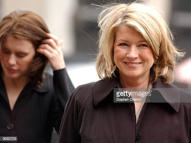 Martha Stewart smiles as her daughter Alexis Stewart pushes her hair back as they arrive at federal court March 2 2004 in New York City In his...