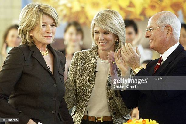 Martha Stewart smiles as she is applauded by Susan Lyne President and CEO and Charles Koppleman ViceChairman both of Martha Stewart Living prior to...