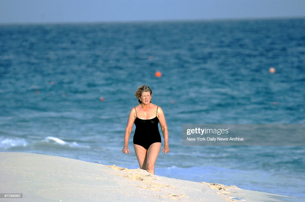 Martha Stewart walks on the beach after an early morning swim at the One and Only Ocean Club on Paradise Island in the Bahamas. Stewart is set to surrender to the federal prison camp in Alderson, W. Va., on Friday to start serving her five month sentence for conspiracy, obstruction of justice and lying to government agents stemming from the ImClone stock scandal.