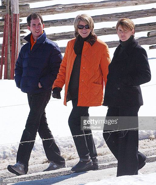 Martha Stewart walks with daughter Alexis and an unidentified man on her estate March 5 2005 in Katonah New York Stewart was released from jail March...