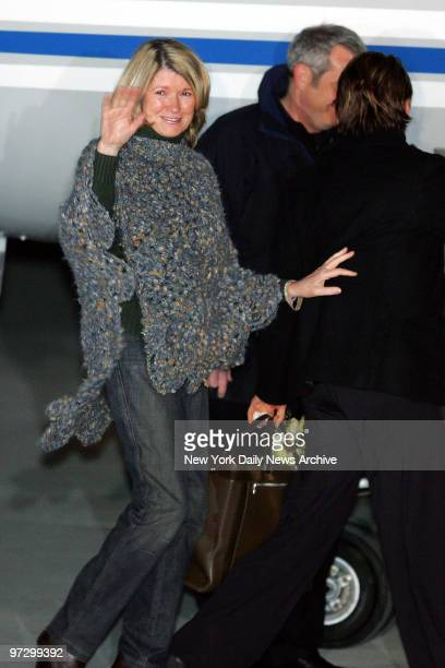 Martha Stewart waves cheerfully as she boards a plane at the Greenbriar Valley Airport in Lewisburg W Va after her release from Alderson Federal...