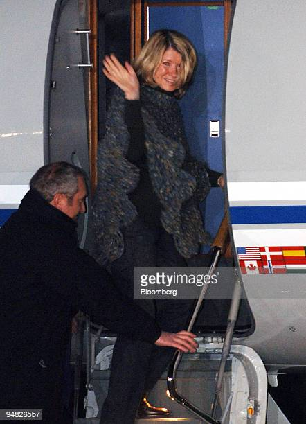 Martha Stewart waves to the media and wellwishers as she boards a private jet at Greenbrier Valley Airport in Lewisburg W Va early Friday March 4...