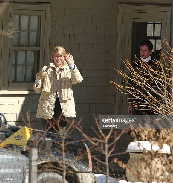 Martha Stewart waves to the media from her porch in Bedford New York on March 4 2005 after being released early in the morning from federal prison in...