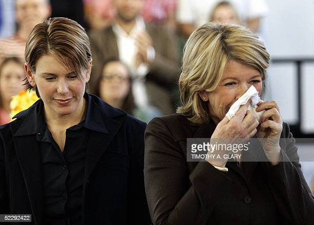 Martha Stewart wipes her face as she arrives with her daughter Alexis on her first day back to work at Martha Stewart Living Offices in New York 07...