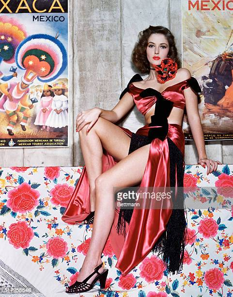 Martha Vickers, star of Warner Brothers musical film, The Time, The Place and The Girl, can throw a six-gun with the best of them. And that dazzling...