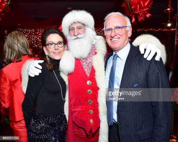 Martha Webster Santa Claus and Peter Webster attend A Christmas Cheer Holiday Party 2017 Hosted by George Farias and Anne and Jay McInerney at The...