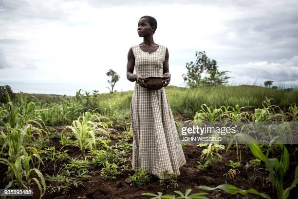 Martha who has been displaced with her husband and five children for six months plants seeds in a makeshift camp for Internally Displaced Persons and...