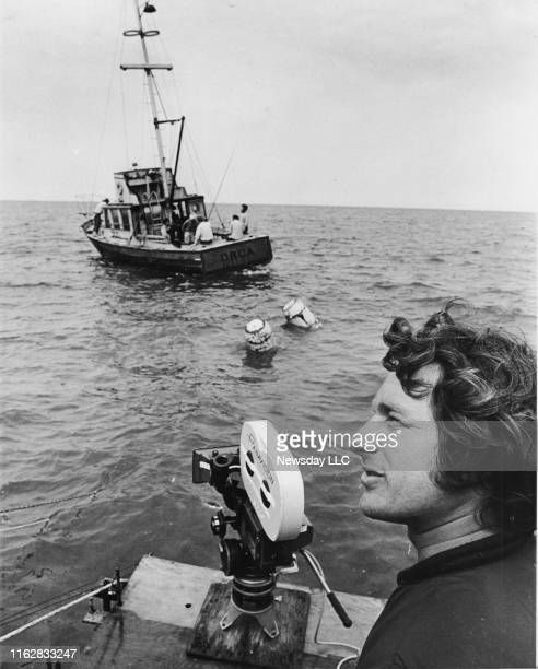 Martha's Vineyard Mass Steven Spielberg waits for the crew to start filming a scene of Jaws with the actors on a boat in the Nantucket Sound off of...