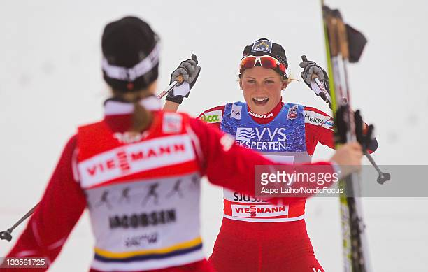 Marthe Kristoffersen of Norway brings the team Norway II to the second place and the team mate Astrid Jacobsen of Norway comes to congratulate her in...