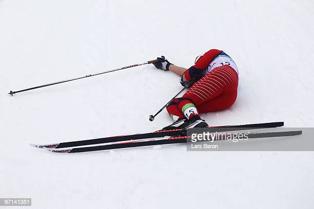 Marthe Kristoffersen of Norway collapses after crossing the finish line during the ladies' 30 km mass start crosscountry skiing classic on day 16 of...
