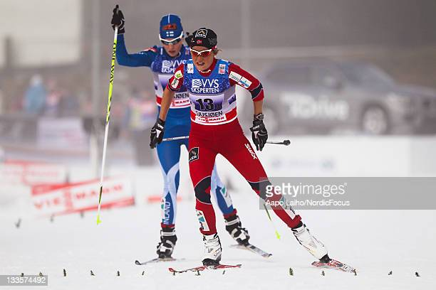 Marthe Kristoffersen of Norway competes ahed of Riikka SarasojaLilja of Finland in the women's 4x5km Cross Country Skiing Relay during the FIS World...