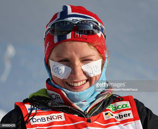 Marthe Kristoffersen of Norway wishes Merry Christmas during the Women's 15km Mass Start in the FIS Cross Country World Cup on December 20 2009 in...