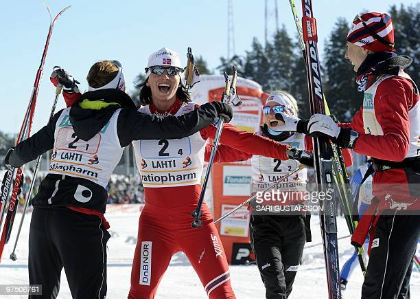 Marthe Kristoffersen Therese Johaug and Kristin Steira embraces anchor Marit Björgen who secured the victory for Norway I in the ladies' 4 x 5 km...