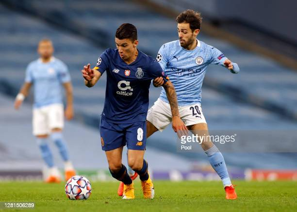 Martheus Uribe of FC Porto is challenged by Bernardo Silva of Manchester City during the UEFA Champions League Group C stage match between Manchester...