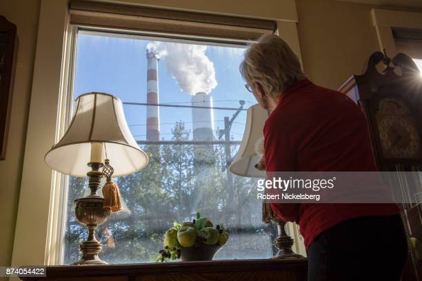 Marti Blake looks out her front window at the smoke stack of the 47year old Cheswick coalfired power plant October 27 2017 in Springdale Pennsylvania...