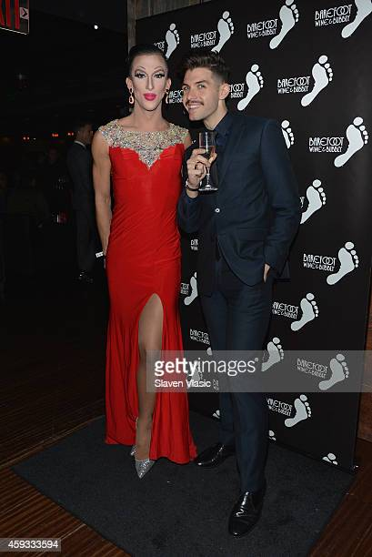 Marti Gould Cummings and guest toast with Barefoot Bubbly at OUT100's 20th Anniversary at Stage 48 on November 20 2014 in New York City