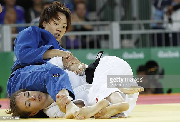 US Marti Malloy competes with Taiwan's Lien ChenLing during their women's 57kg judo contest match of the Rio 2016 Olympic Games in Rio de Janeiro on...