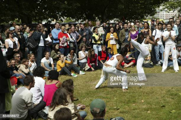 Martial art dancers entertain the crowds as they help celebrate the 50th Aniversary of Bossa Nova on the South Bank of the River Thames in London