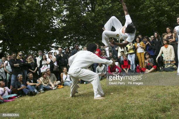 Martial art dancers entertain the crowds as they help celebrate the 50th Anniversary of Bossa Nova on the South Bank of the River Thames in London
