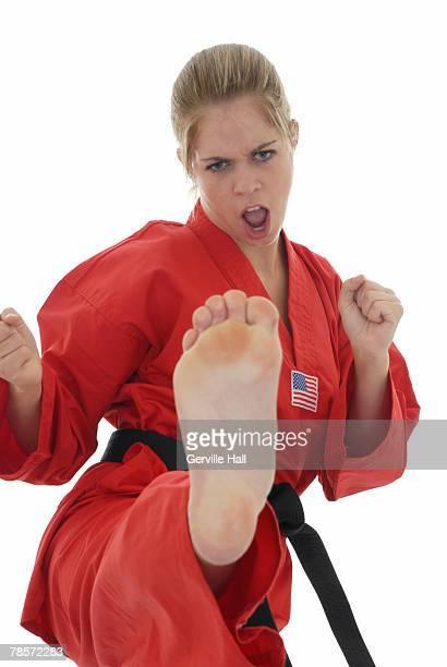 Martial artist front kicking.