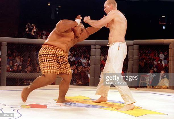 Martial artist Gerard Gordeau of Amsterdam Holland lands a left to the head of Sumo wrestler Teilo Tuli of Honolulu HA is during the Ultimate Fighter...