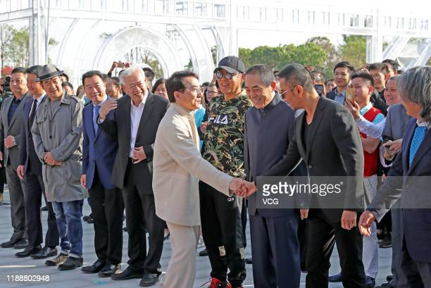 Martial artist Jackie Chan and actor Zhang Hanyu shake hands with each other at the unveiling ceremony of Golden Rooster sculpture during the 28th...
