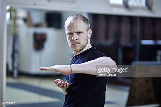 Martial artist performing Kata in a studio