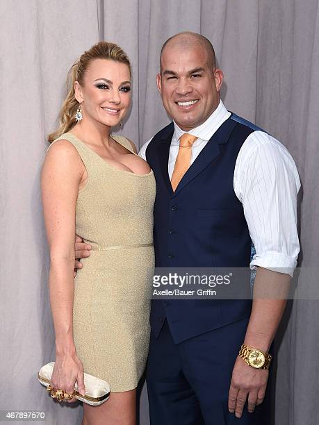 Martial artist Tito Ortiz and Amber Nichole Miller arrive at the Comedy Central Roast of Justin Bieber on March 14 2015 in Los Angeles California