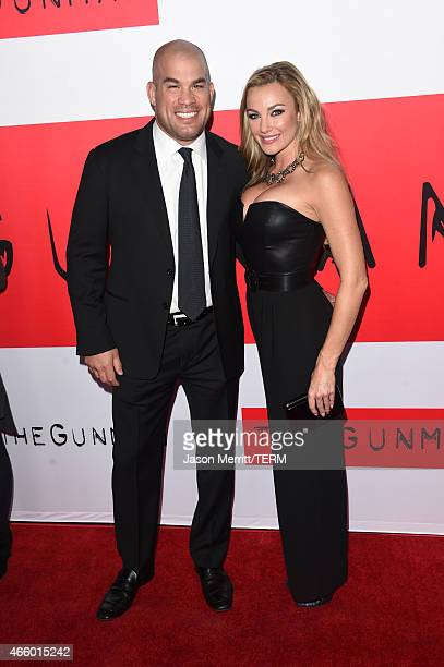 Martial artist Tito Ortiz and Amber Nichole Miller attend the premiere of Open Road Films' The Gunman at Regal Cinemas LA Live on March 12 2015 in...