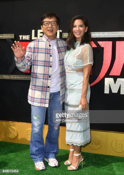 Martial arts action star Jackie Chan and actress Olivia Munn who play the voices of 'Master Wu' and 'Koko' respectively arrive for the premiere of...