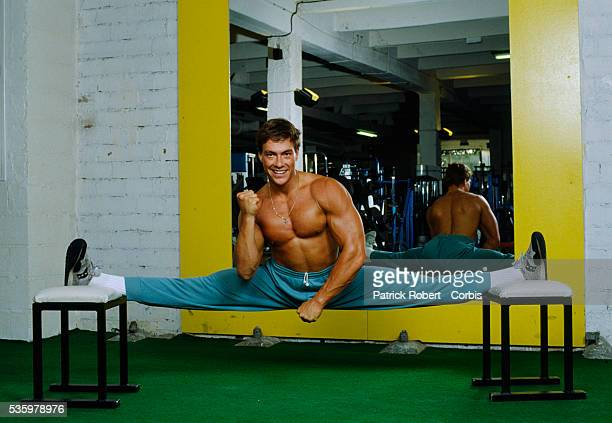 Martial arts actor JeanClaude Van Damme working out at the Weider Gym in Paris in 1988