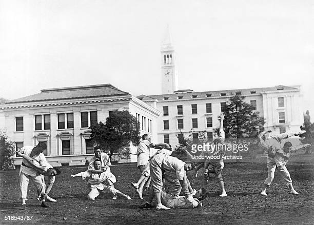 A martial arts class practices on the University of California campus with the Campanile rising in the background Berkeley California late 1890s or...