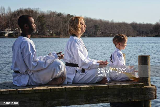 martial arts meditation on the lake - gerville stock pictures, royalty-free photos & images